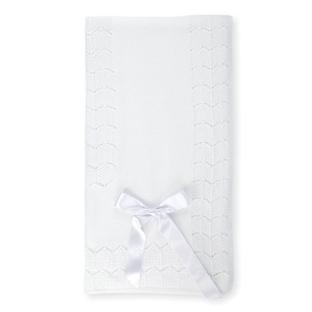 Gestrickte Decke mit Schleife weiß